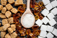 Cooking sweets set with sugar in spoons on kitchen table background top view pattern Royalty Free Stock Photo