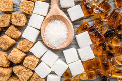 Cooking sweets set with sugar in spoons on kitchen table background top view pattern Royalty Free Stock Image