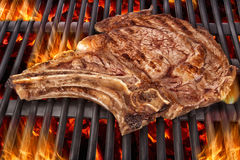 Cooking t bone steak on barbecue Stock Photography