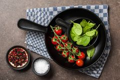 Cooking table with fresh tomatoes, spinach leaves and spices stock photos