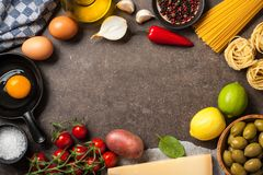 Cooking table with ingredients royalty free stock images