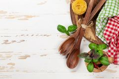Cooking table with utensils and ingredients Stock Photos