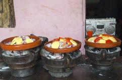 Cooking tajine on coal Royalty Free Stock Photography