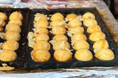 Cooking Takoyaki on hot pan Famous food Osaka Japan. Street food Royalty Free Stock Images