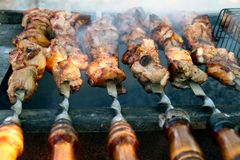 Cooking of tasty BARBECUE outdoors, closeup. royalty free stock photo