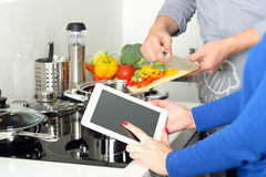 Cooking, technology and home concept - closeup of woman pointing finger to tablet pc computer royalty free stock photo