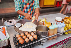 Cooking Thai Banana Pancake on the street Royalty Free Stock Photography