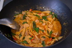 Cooking Thai Chicken Red Curry in the Wok, Thai Food, Thai Cuisi Royalty Free Stock Image