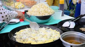 Cooking Thai cuisine Oyster omelette or mussel fried in egg batter stock video footage