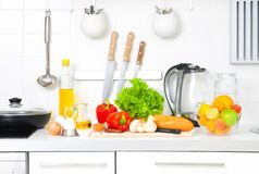 Cooking time. Abundance  of fruits and vegetables on kitchen table Royalty Free Stock Photo