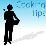 Cooking Tips. An image of a cooking tips woman holding a spoon and mixing bowl Stock Photography