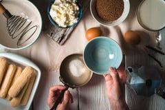 Cooking tiramisu on the white wooden table  horizontal Royalty Free Stock Photography