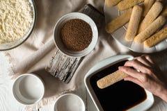 Cooking tiramisu on the white wooden table  top view Stock Photos