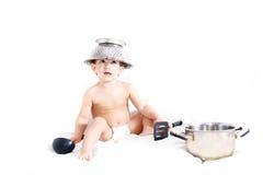 Cooking toddler in colander hat Stock Image