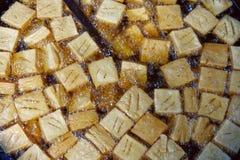 Cooking tofu fries in oil - street food, Kathmandu, Nepal Royalty Free Stock Images