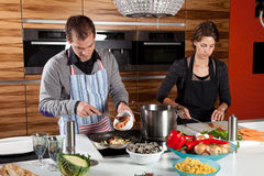 Cooking together Stock Photos