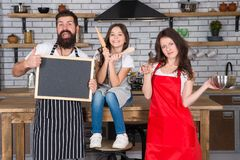 Cooking together. Family mom dad and daughter wear aprons stand in kitchen. Cooking food concept. Prepare delicious meal. Breakfast time. Family having fun royalty free stock photos