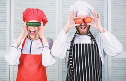 Cooking together is fun. Menu for our family. Go vegan. Organic nutrition. Vegan family. Man and woman chef hold royalty free stock photos