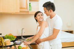 Cooking together. Image of a young couple standing in the kitchen and embracing Royalty Free Stock Photography