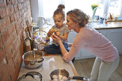 Cooking together with mom Stock Photography