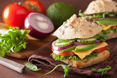 Cooking tomato avocado cheese sandwich with cucumber onion Royalty Free Stock Photography