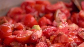 Cooking tomato sauce close-up. Cook add fresh tomato in pan, slow motion. stock footage