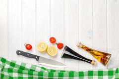 Cooking with tomatoes, lemons and condiments Stock Photography