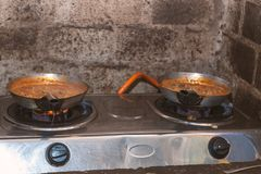 Cooking of traditional african dishes in restaurant royalty free stock photo