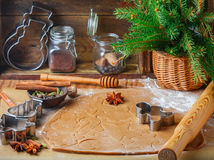 Cooking traditional biscuits and gingerbread. Christmas. New year. Dough, cutting the cookies and the spices on the table. Cinnamon sticks, cardamom, nutmeg Royalty Free Stock Photography