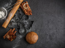 Cooking traditional biscuits and gingerbread. Christmas. New year. Dough, cutting the cookies and the spices on the table. Cinnamon sticks, cardamom, nutmeg Stock Photography