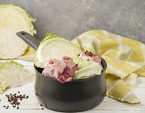 Cooking the traditional Norwegian dish of braised cabbage with l stock photography