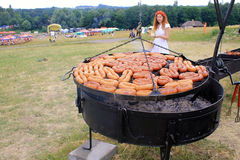 Cooking traditional sausages on grill outdoor pan in Museum Piro Stock Photos