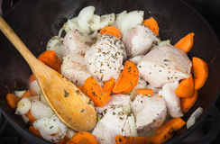 Cooking turkey with vegetables Stock Image