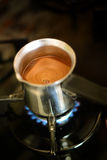 Cooking Turkish coffee in pot Stock Photo