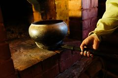 Cooking in a typical Russian stove. Closeup Stock Photos