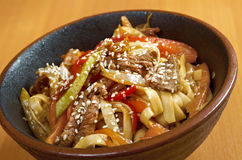 Cooking udon teppanyaki with pork Stock Photography