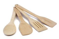 Cooking utensils. Kitchen accessories (spatulas and a spoon) from a bamboo on a white background Royalty Free Stock Images