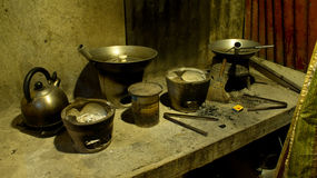 Typical Asian rural cooking utensils. A typical Asian dirty kitchen, and still can be found to be used by poor people in rural areas. Wood and coal are used to Royalty Free Stock Photo