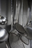 Cooking utensils. Hanging on a wall stock images