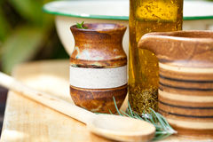 Cooking Utensils - earthernware and herbs royalty free stock images