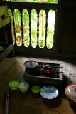 Cooking utensils in Ethnic Malay kitchen. A photograph showing some traditional antique utensils and old charcoal open stove for cooking ethnic Malaysian style Royalty Free Stock Images