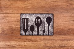 Cooking utensils silhouette drawing in flour royalty free stock photography