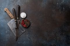 Cooking utensils and spices. Over stone table. Salt and pepper. Top view with space for your recipe Royalty Free Stock Photography