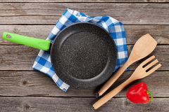Cooking utensils on wooden table Stock Images
