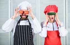 Cooking vegan meal. Cooking together is fun. Menu for our family. Go vegan. Organic nutrition. Vegan family. Man and. Women chef hold vegetables having fun stock image
