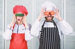 Cooking vegan meal. Cooking together is fun. Menu for our family. Go vegan. Organic nutrition. Vegan family. Man and. Women chef hold vegetables having fun royalty free stock image