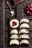 Cooking of vegan pierogies from cherry Stock Images