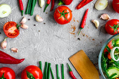 Cooking vegetables on the stone background top view Royalty Free Stock Image
