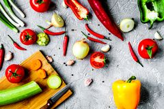 Cooking vegetables on the stone background top view Royalty Free Stock Photography