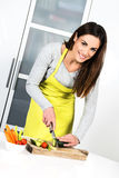 Cooking vegetables. Young Woman Cooking. Healthy Food - Vegetable Salad. Diet. Dieting Concept. Healthy Lifestyle. Cooking At Home. Prepare Food stock photography
